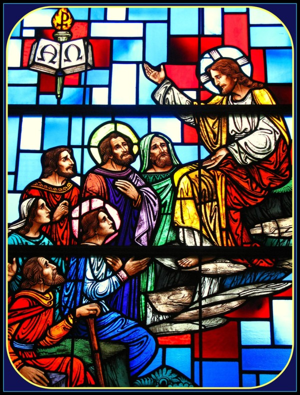 stained glass image of the sermon on the mount