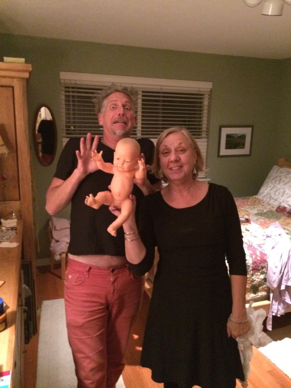 a couple with a fake scary baby